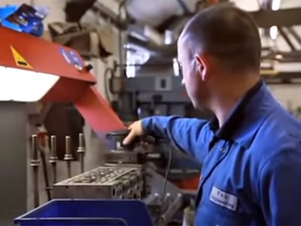 Man Cleaning Cylinder Head | T&L Engineering Bedford