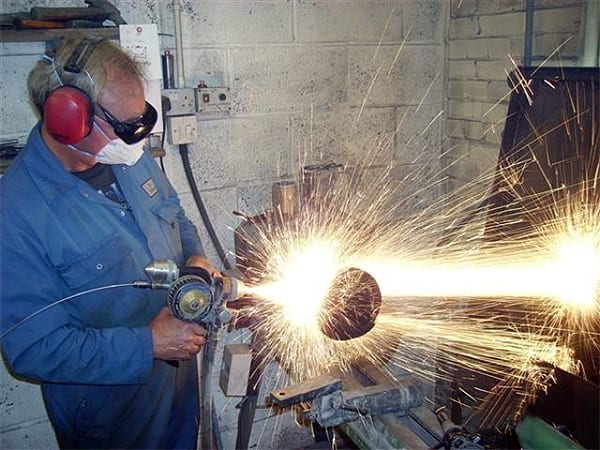 Man Grinding with Sparks | T&L Engineering Bedford